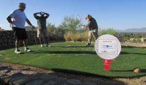 Cooper Bolton shows off his backswing with John Courtemanche (left) and Chris Montgomery looking on